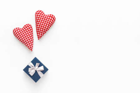 Valentines day composition. Two soft red hearts and gift box on white background. Flat lay, top view, copy space