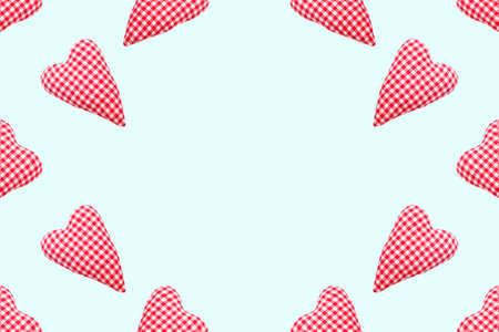 Valentines day background. Top view soft red heart pads on pastel blue background. Love concept flat lay. Copy space