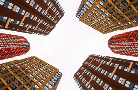 Modern architecture. Colored Skyscrapers. Multi-storey residential buildings. Vertical perspective up into the sky. Isolate. Copy space