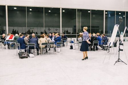 Russia, city Moscow - December 18, 2017: A group of people in the room. Business Training. Team workout meeting concept. Business trainer. Audience in the conference room 新聞圖片