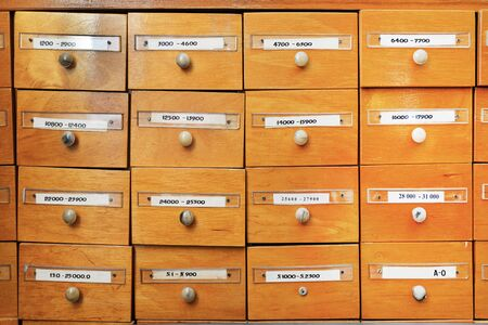 Library of account cards. File cabinet for library cards. Vintage cabinet. Cells for storing information, database. Library boxes