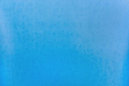Blue abstract background. The texture of decorative leather. Soft effect, template for design. Zdjęcie Seryjne