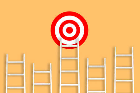 White stairs on an orange background and a target. Striving for goals, success and achievements. Career ladder. The concept of leadership in business and at work Stock Photo