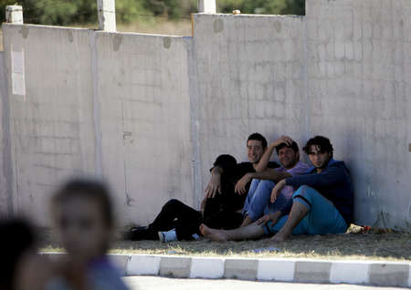demarcation: Pastrogor, Bulgaria, September 25, 2013 - Syrian refugees take a rest at a detention center on September 25, 2013 in Pastrogor, Bulgaria  Editorial