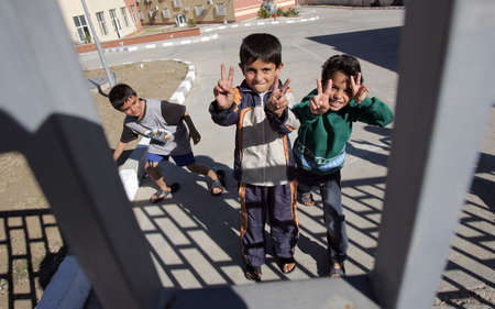 Pastrogor, Bulgaria, September 25, 2013 - Unidentified syrian refugees boys shows peace sign in detention center in the town of Pastrogor on September 25, 2013 in Pastrogor, Bulgaria