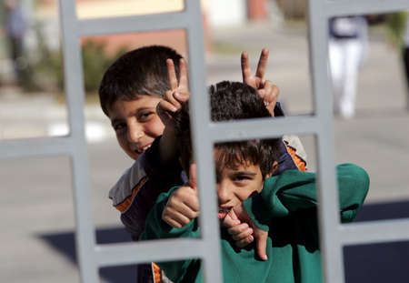 demarcation: Pastrogor, Bulgaria, September 25, 2013 - Unidentified syrian refugees boys shows peace sign in detention center in the town of Pastrogor on September 25, 2013 in Pastrogor, Bulgaria