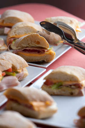 Ciabatta sandwiches with cheese, ham and cucumber. photo