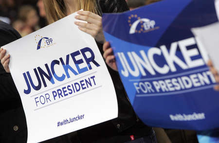 pres: Supporters of EPP holds boards with name of candidate for the post of EC Pres Jean-Claude Juncker during opening of the European elect campaign on April 27, 2014 in Sofia, Bulgaria