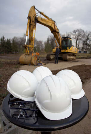 groundbreaking: Worker helmets and goggles stand before starting groundbreaking ceremony.