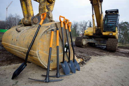 groundbreaking: Worker tools stand before starting groundbreaking ceremony. Stock Photo
