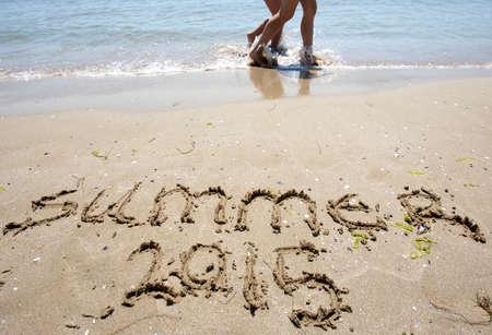 New year 2015 written in sand. photo