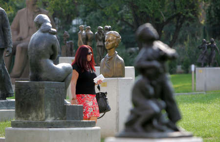 BULGARIA, SOFIA - SEPTEMBER 19: A group of tourists have a tour at The Museum of Socialist Art (MSA) during opening ceremony on September 19, 2011 in Sofia, Bulgaria. Editorial