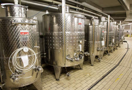 vats: Modern aluminum barrels for wine in wine factory