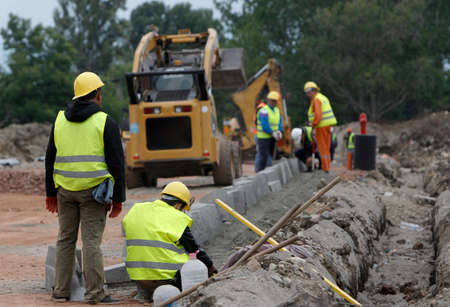 laborers: Laborers work at a road construction site. Stock Photo