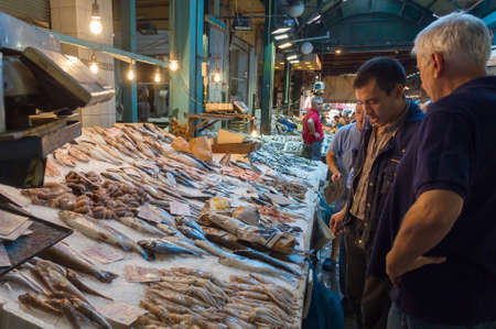 4 people: THESSALONIKI, GREECE - SEPTEMBER 4: People shopping in Modiano Market on September 4, 2015 in Thessaloniki.