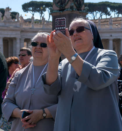 praying together: Crowds of pilgrims gathered on April 10, 2016 at Saint Peters Square in Vatican. Thousands of people are praying together with Pope Francis every Sunday.