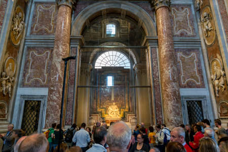 basilica of saint peter: VATICAN CITY, VATICAN - APRIL 10: People are looking inside the basilica Saint Peter in Vatican on April 10, 2016 in Vatican City, Vatican.
