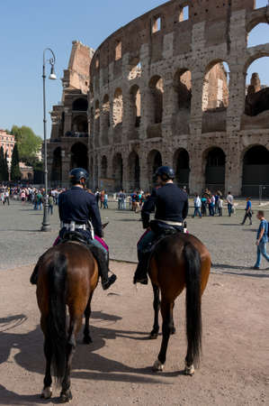 1st century ad: ROME, ITALY - APRIL 7: Colosseum was built in the first century AD by the Emperor Vespasian. Policemen on horses patrol near the Colosseum on April 7, 2016, Rome, Italy. Editorial