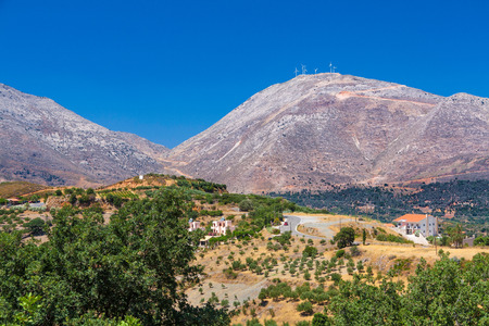 Typical Cretan landscape  hills, olives and wind-power usage