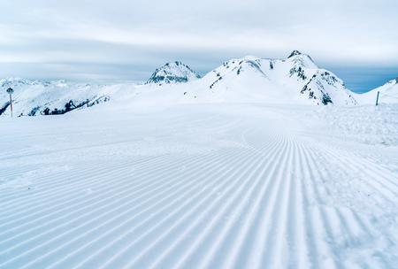 SKI: Ski slope just prepared for skiing.