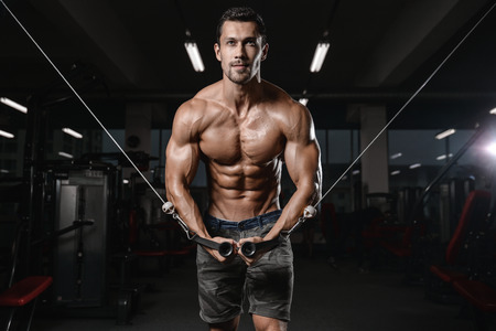 energy work: man with weight training in gym equipment sport club Stock Photo