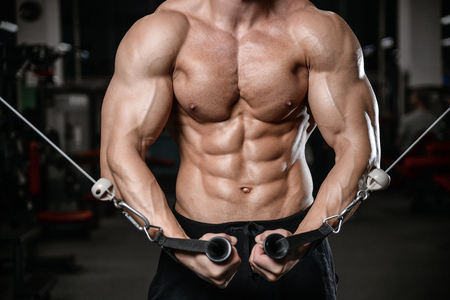 young man train in the gym healthcare lifestyle sexy caucasian man bodybuilder work out naked body torso diet in joy