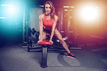 Fitness sexy mode on diet with long female legs in the gym Stock Photo
