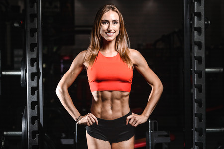 Pretty caucasian sexy fitness female model in gym close up abs concept man on diet shirtless training six pack healthcare lifestyle crunch Stock Photo