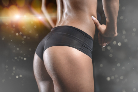Pretty fitness sexy model luxury ass. Caucasian female on diet with perfect body in gym and buttocks fat burning concept