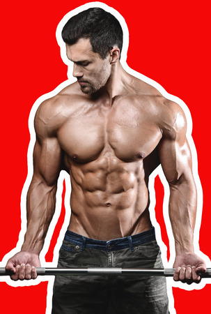 execute: Handsome power athletic man on diet training pumping up muscles with dumbbell and barbell. Strong bodybuilder with six pack, perfect abs, shoulders, biceps, triceps and chest
