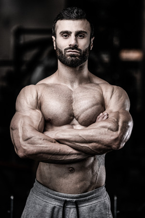 physique: Sexy portrait of a very muscular shirtless male model looking away