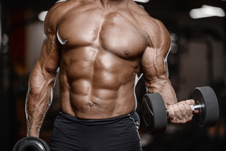 old brutal sexy strong bodybuilder athletic fitness man pumping up abs muscles workout bodybuilding concept background - muscular handsome men doing health care fitness exercises in gym naked torso