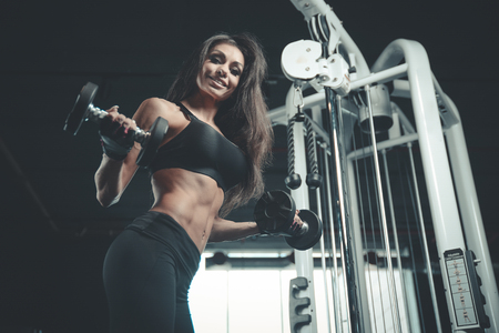 Beautiful sexy athletic young caucasian girl working out Standard-Bild