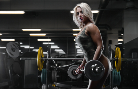 active beautiful Caucasian athletic fit sexy young blonde woman on diet posing showing well rounded butt ass glutes tight buttocks and legs fitness exercise training and bodybuilding erotic concept Foto de archivo
