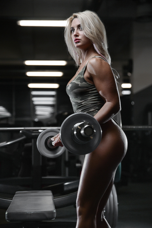 active beautiful Caucasian athletic fit blonde woman posing showing well rounded butt ass glutes tight buttocks and legs fitness exercise training and bodybuilding concept