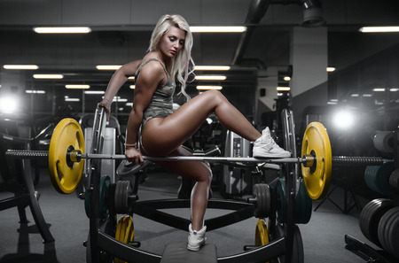 active beautiful Caucasian athletic fit sexy young blonde woman on diet posing showing well rounded butt ass glutes tight buttocks and legs fitness exercise training and bodybuilding erotic concept Imagens