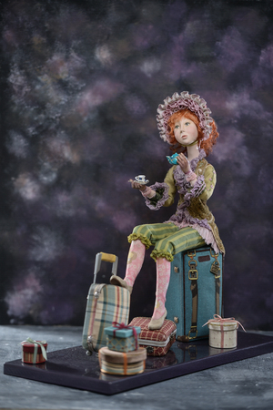Porcelain paper mache clay statuette girl pretty woman young girl dress redhead beauty handmade handcrafted toy craft vintage silk bonnet hat cap teacup cup tea teapot decor doll gift texture concept 写真素材