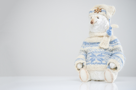 Woolen polar teddy snow bear knitted sweater hat scarf toy beauty handmade handcrafted background craft vintage white blue cute decor doll gift texture concept Stok Fotoğraf