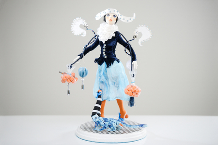 Porcelain paper mache clay statuette girl pretty woman young girl skirt brunette beauty handmade handcrafted toy craft vintage satin jacket winter cat blue orange decor doll gift texture concept