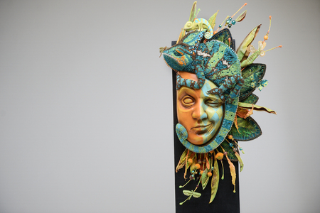 Porcelain paper mache clay Venice Italian carnival chameleon colourful mask beauty handmade handcrafted toy craft vintage flowers decor doll gift texture concept 版權商用圖片