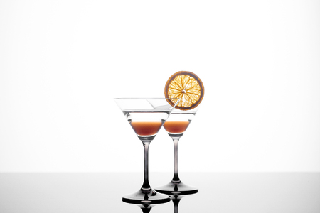 martini glass on a white background with an orange slice Stock Photo