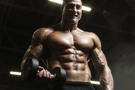 Handsome strong athletic men pumping up muscles workout barbell curl bodybuilding concept background - muscular bodybuilder men doing exercises in gym naked torso Standard-Bild - 118552590