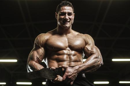 Handsome strong athletic men pumping up muscles workout bodybuilding concept background - muscular bodybuilder handsome men doing exercises in gym naked torso Standard-Bild - 118552607