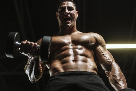 Handsome strong athletic men pumping up muscles workout barbell curl bodybuilding concept background - muscular bodybuilder men doing exercises in gym naked torso Standard-Bild - 118552573