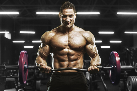 Handsome strong athletic men pumping up muscles workout barbell curl bodybuilding concept background - muscular bodybuilder men doing exercises in gym naked torso
