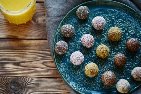Homemade healthy gluten-free no bake energy balls with nuts sesame, chia seed and dried fruits vegan vegetarian raw snack or meal cook energy bites Dietary sweets Clean food Indian vegetarian desserts Banco de Imagens