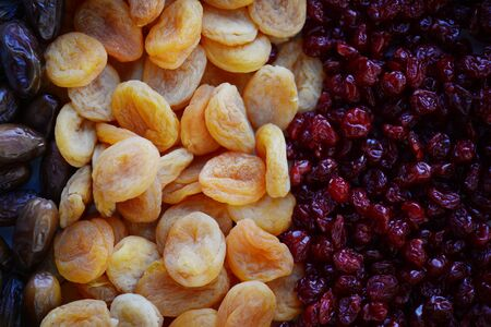 Dried fruit background. Rows of dried dates, apricots,cranberries, nuts, prunes Banco de Imagens