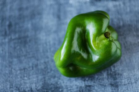 Trendy ugly organic sweet pepper on the table. Horizontal with copy space