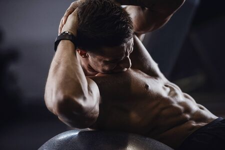 Handsome strong athletic men pumping up muscles workout fitness and bodybuilding concept background - muscular bodybuilder fitness men doing abs exercises in gym naked torso Stok Fotoğraf
