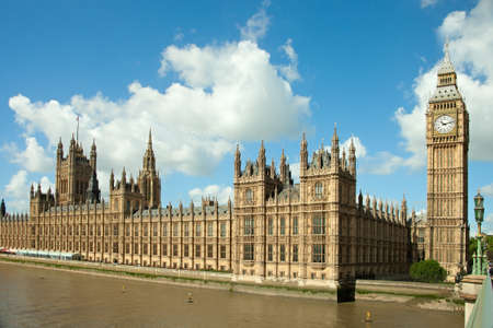 westminster: House of Parliament with Big Ban tower in London UK view from Themes river